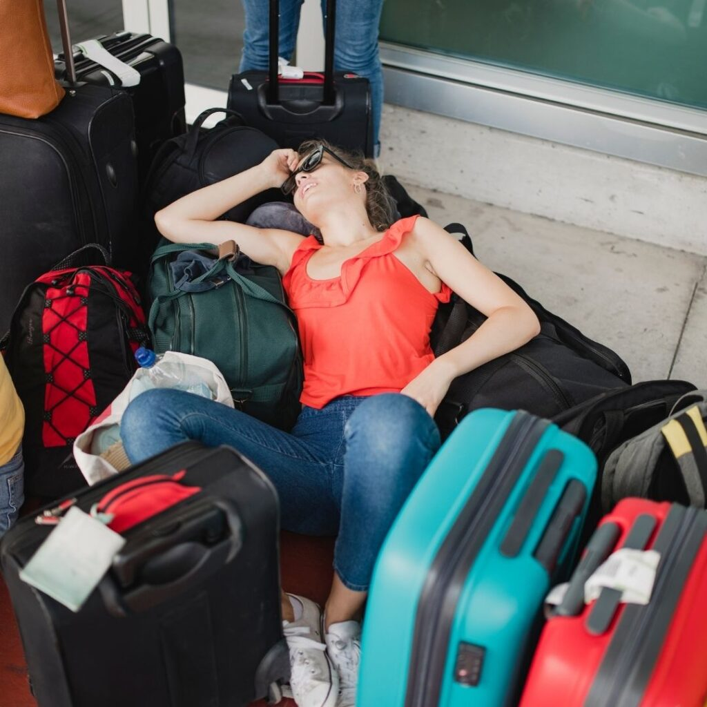 Hotel check in traveler laying in suitcases